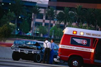 Emergency vehicle helps after car accident. For help with your claim, call our Columbus car accident attorneys.