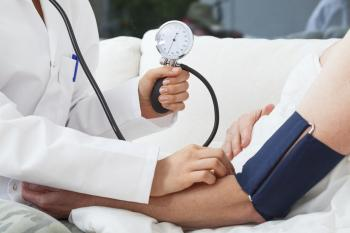 Doctor using a blood pressure cuff. Our Columbus, Ohio medical malpractice attorneys can help if you've been injured