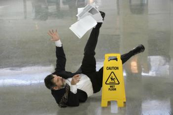 Man slips and falls. Our Columbus, Ohio premises liability attorneys can help get you compensation for your injuries.